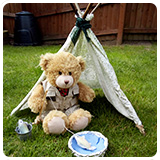 Teddy sat in a wigwam fishing