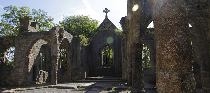 Inside a ruined church on a sunny day