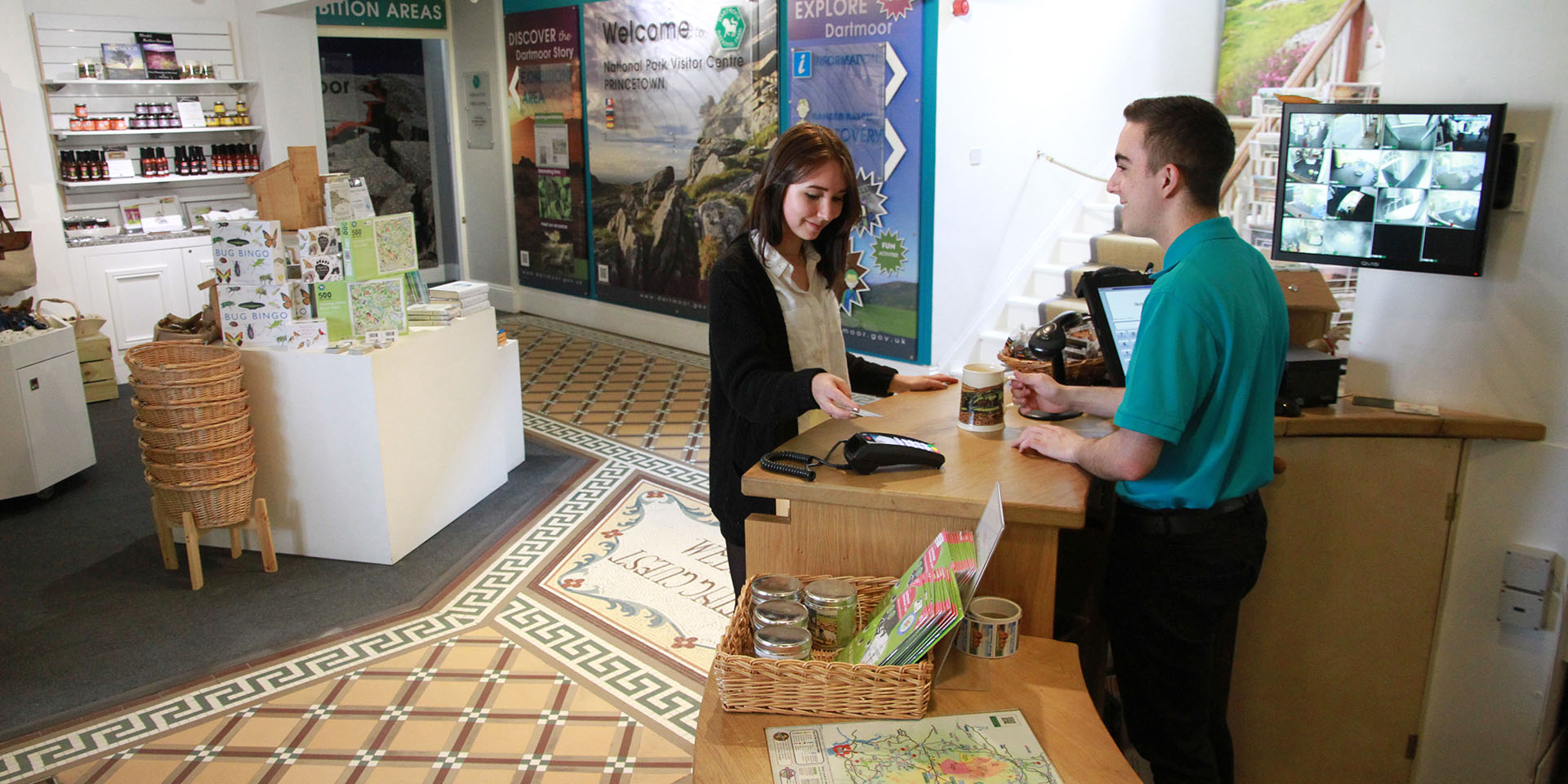Visitor buying product in visitor centre shop