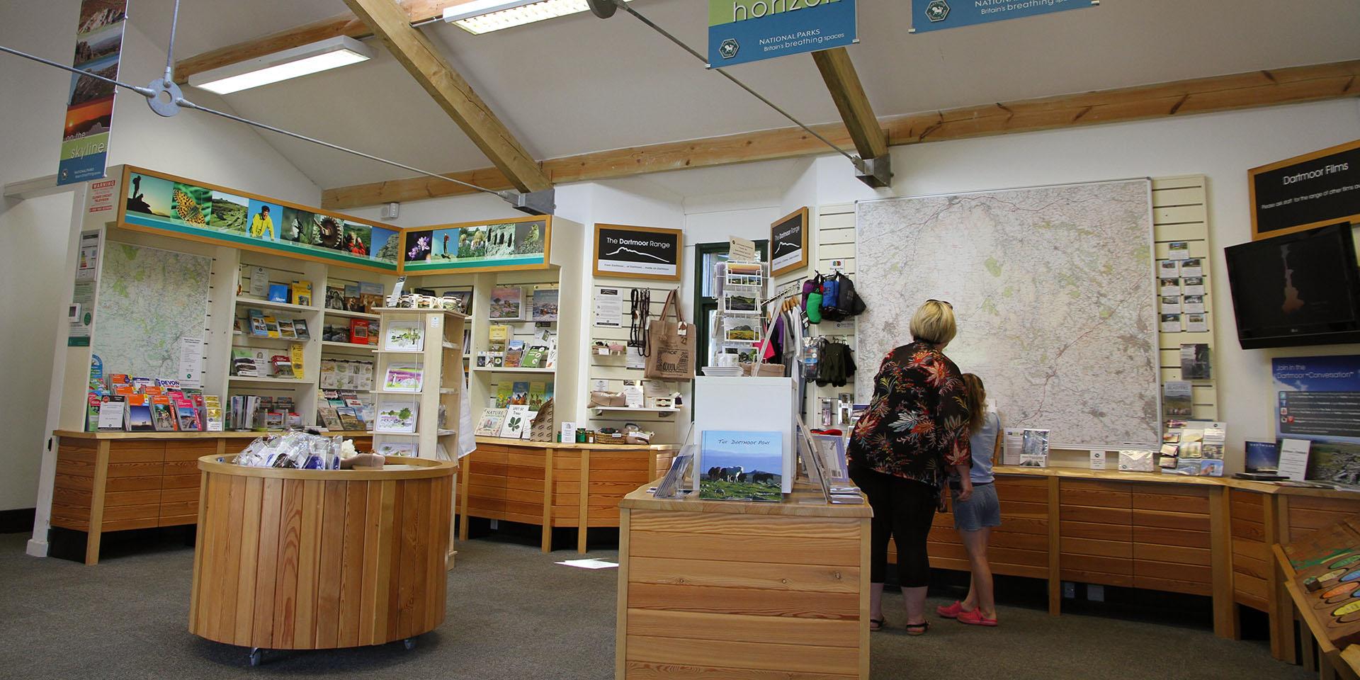 Visitors looking at Haytor Visitor Centre display
