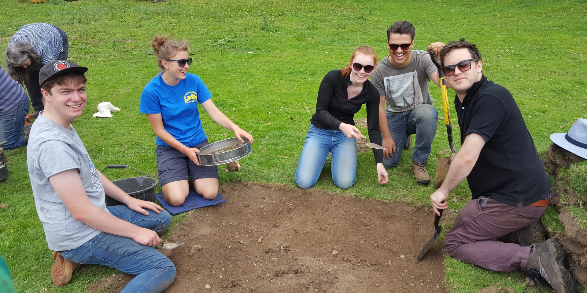 Students digging a test pit