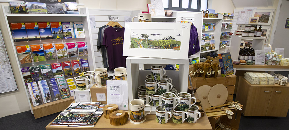 Dartmoor themed t-shirts, mugs, stuffed toys and other retail items on display