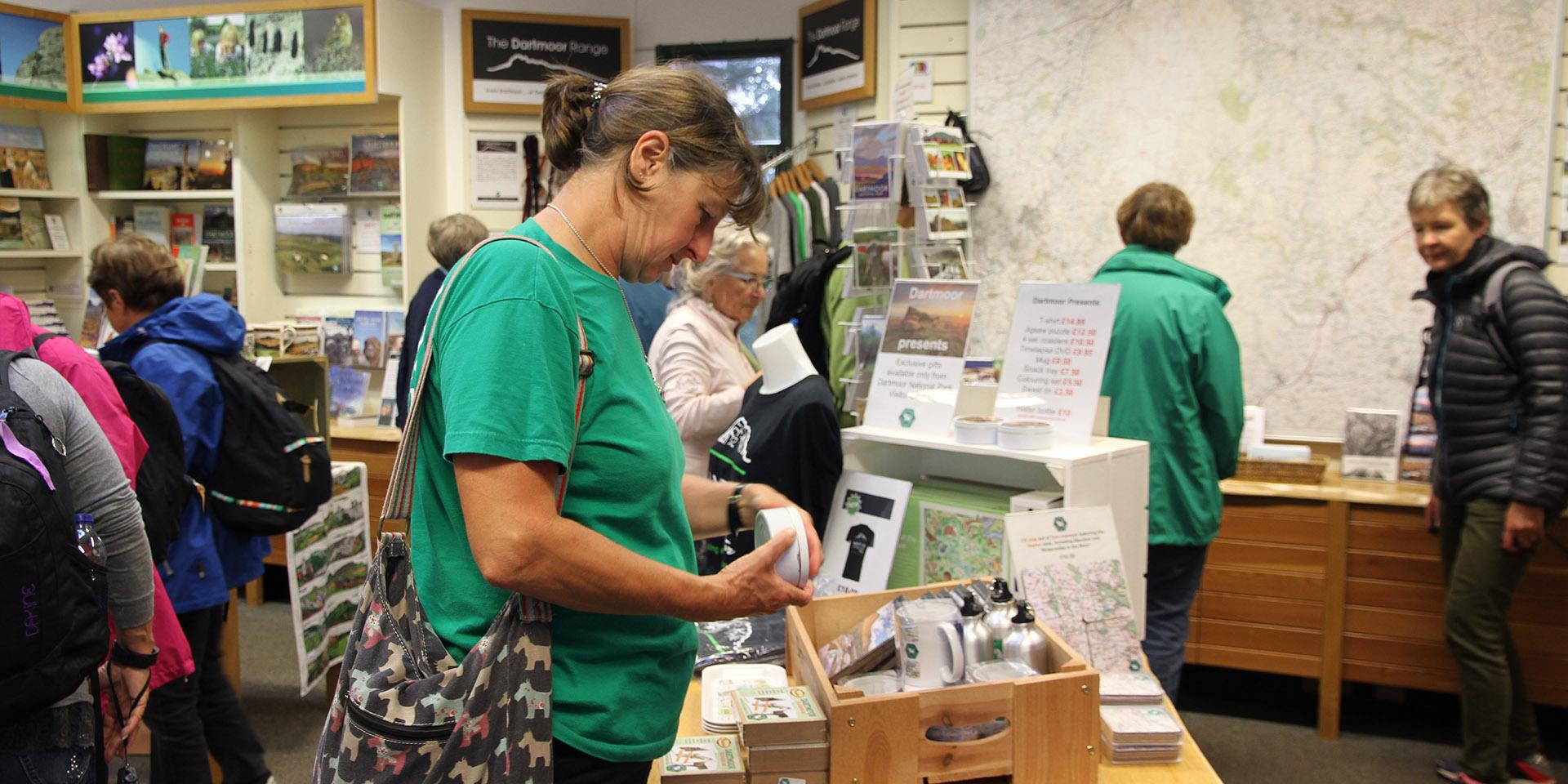 Customer looking at Dartmoor mug