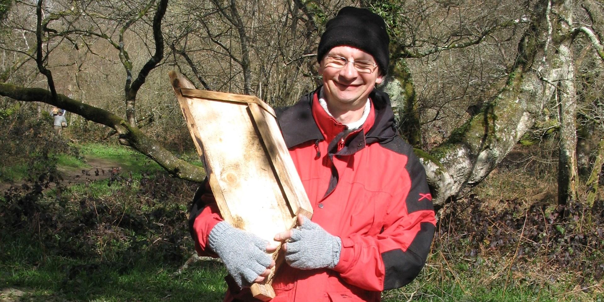 Volunteer helping put up bat box