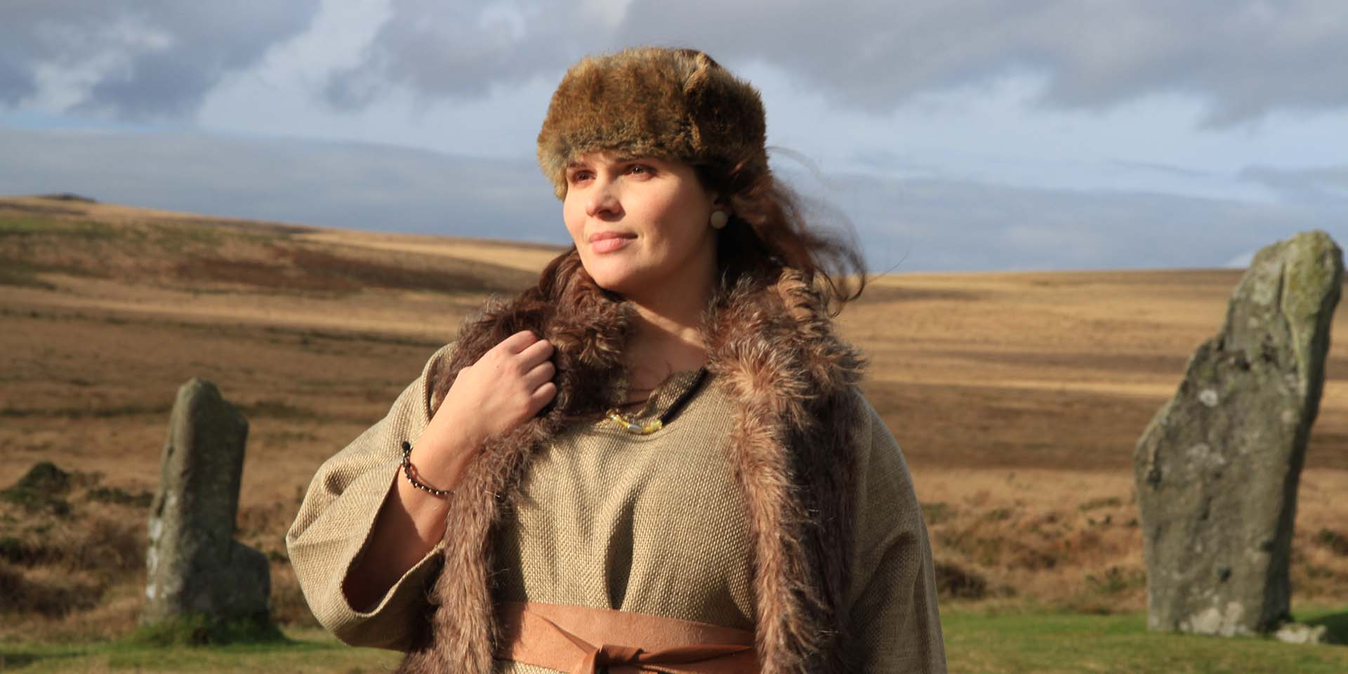 Young woman dressed in Bronze Age clothing and jewellry