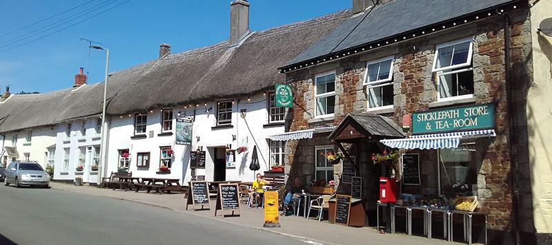 Shop fronts including a tea shop along a road