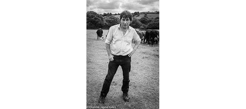 Farmer Bill in field of cows
