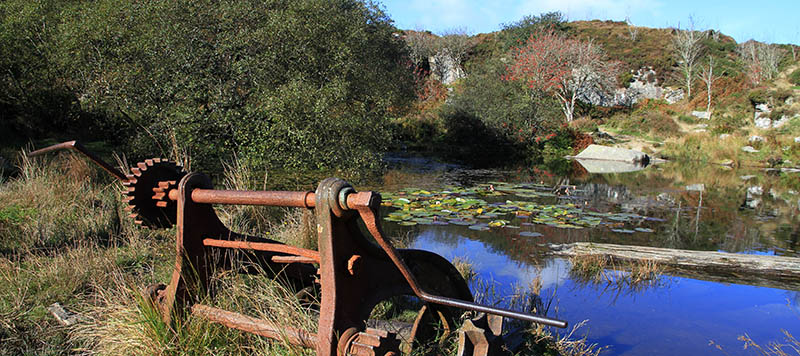 Old winch next to quarry pool
