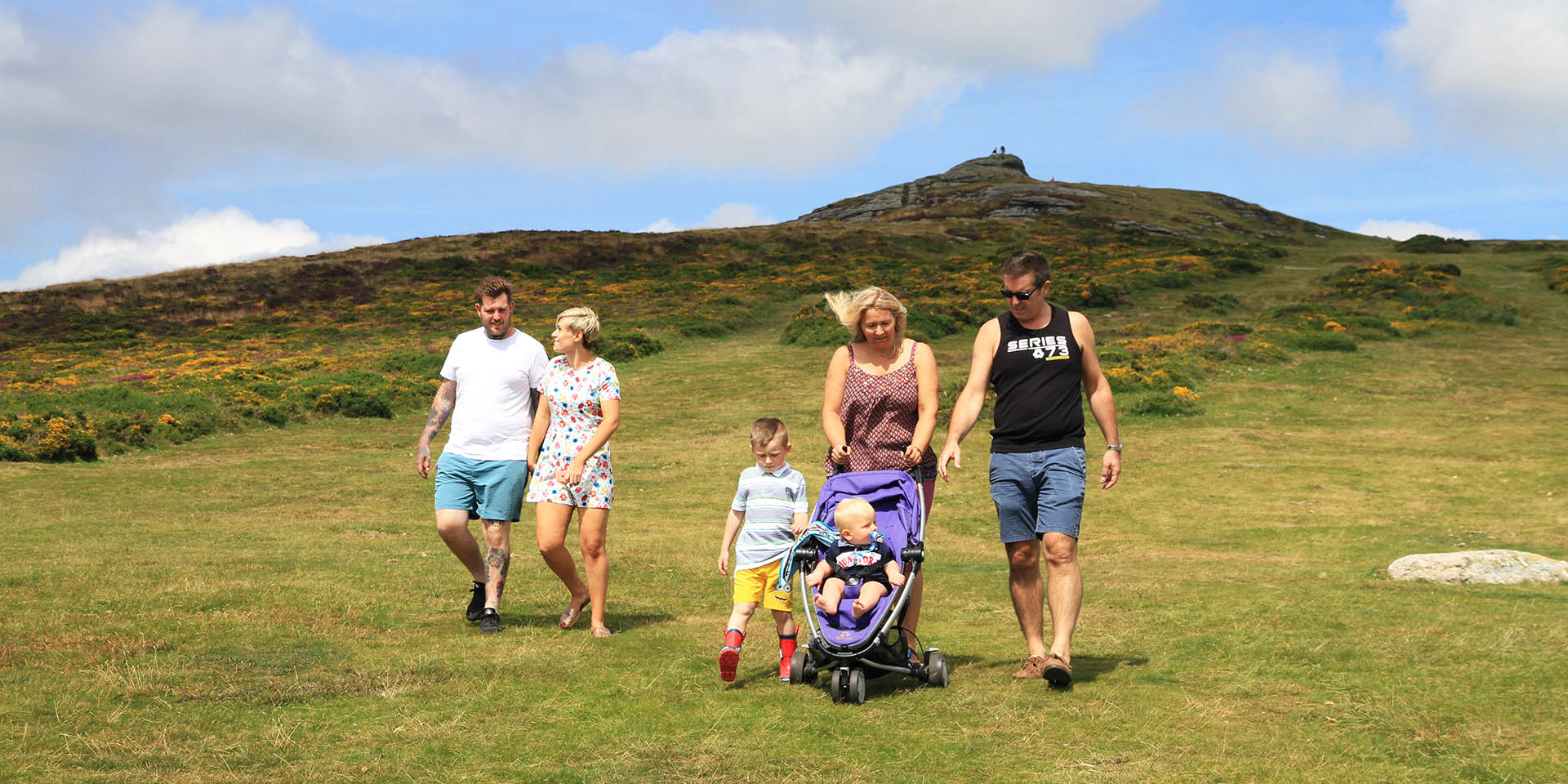 Family walking down from Haytor Rocks