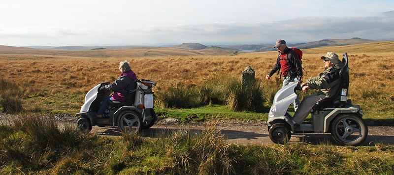 Two disabled ramblers using trampers on Nun's Cross path