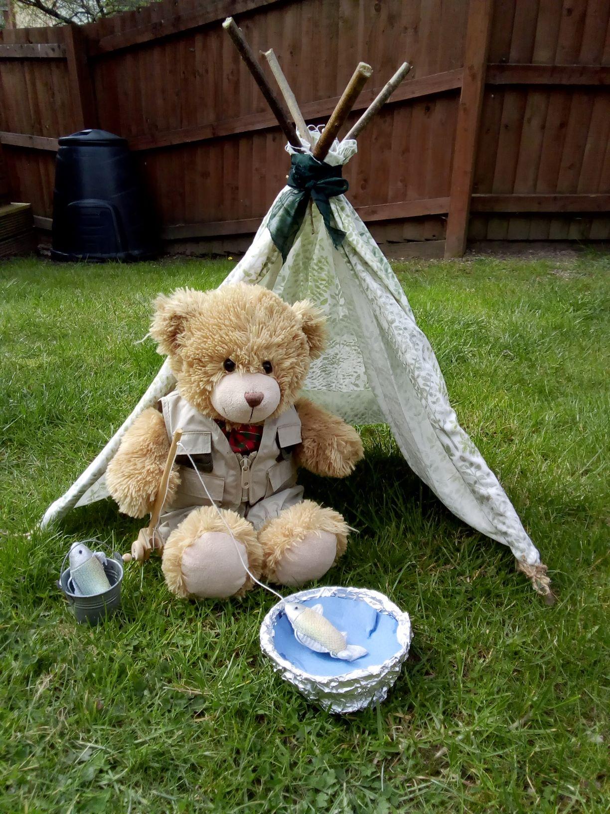 Teddy in a wigwam fishing