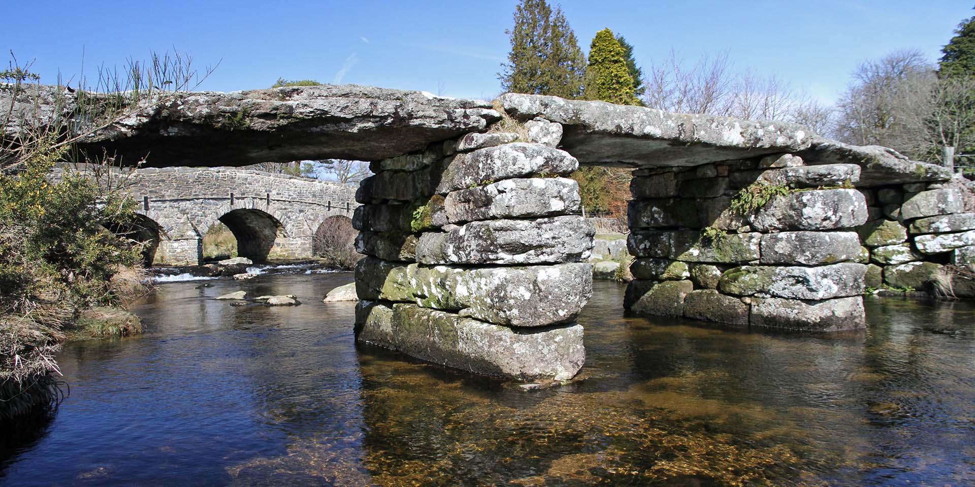 Postbridge clapper bridge and river