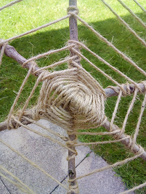 Spider web made out of string and twigs
