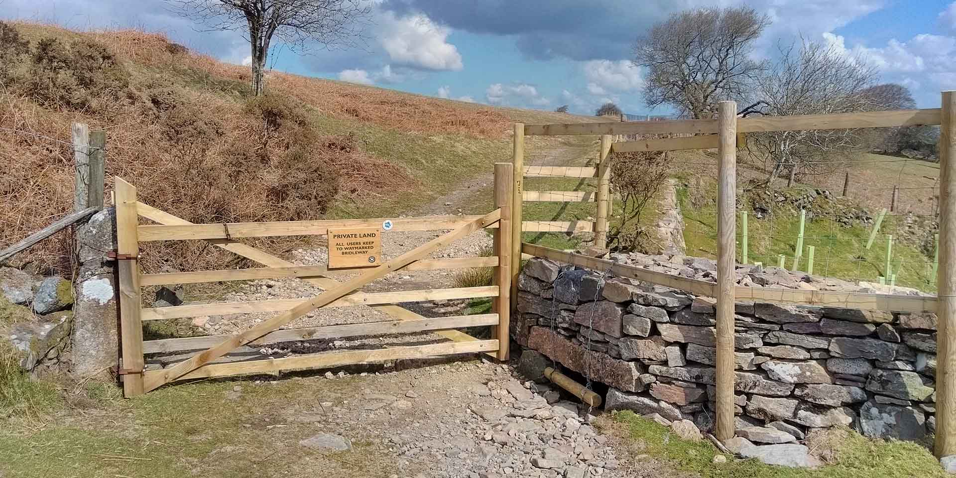 New gate and stone wall